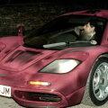 Rowan Atkinson în maşina sa, McLaren F1