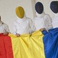 Simona Gherman, Ana Maria Brînză, Anca Măroiu şi Loredana Dinu (de la stînga la dreapta) cu steagul României // Foto: Raed Krishan