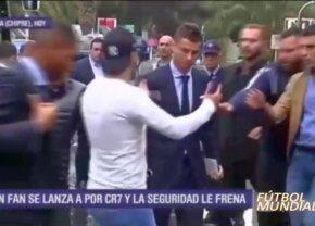 VIDEO Isterie generală în Cipru! 7 bodyguarzi au sărit pe un fan care s-a dat fotoreporter pentru o poză cu Ronaldo