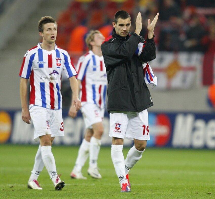 Cornel Rîpă (stînga) și Punosevac la finalul meciului de pe Național Arena