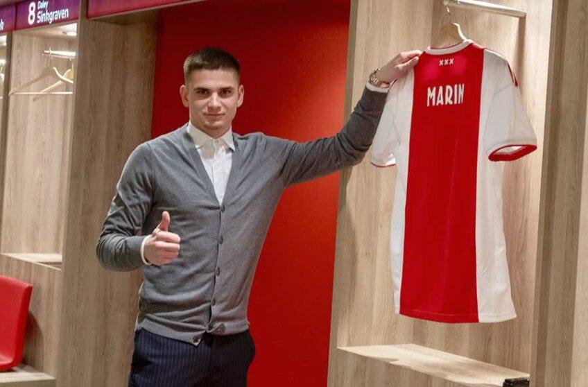Răzvan Marin, 22 de ani, a făcut o vizită la Amsterdam doar pentru semnarea contractului și pentru prezentarea în tricoul alb-roșu