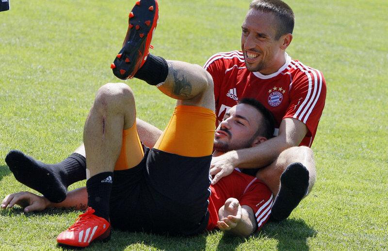 Ribery (dreapta) şi Contento plănuiesc farsa zilei // Foto: Reuters