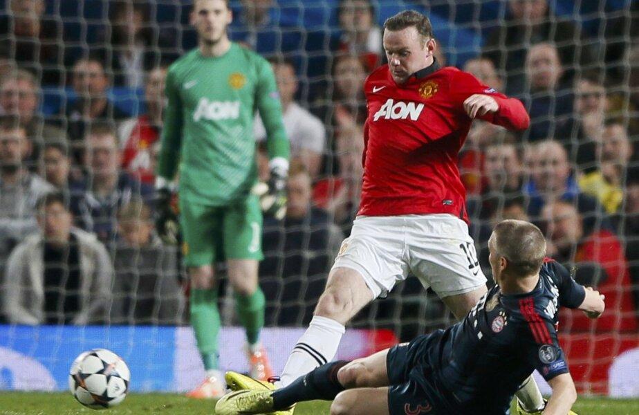 Schweinsteiger îi suflă lui Rooney balonul, acesta cade teatral și obține eliminarea neamțului // Foto: Reuters
