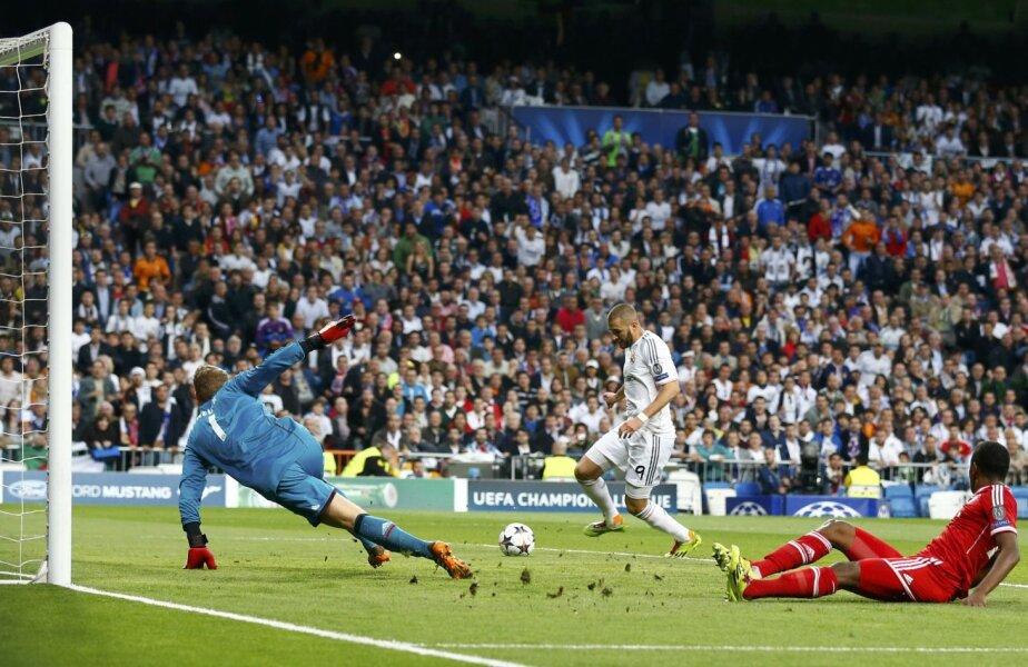 Neuer plonjează ştiind că nu mai are nici o şansă. Benzema nu putea rata cu trei sferturi de poartă goală în faţă // Foto: Reuters