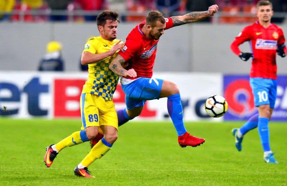 George Călințaru (galben) în duel cu Denis Alibec