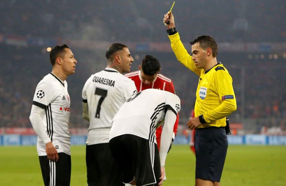 Hațegan arătându-i cartonașul galben campionului european, Quaresma // FOTO: Reuters
